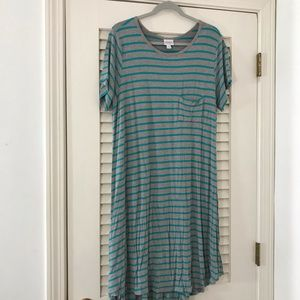 Gently worn Carly, turquoise and gray stripes,XL!